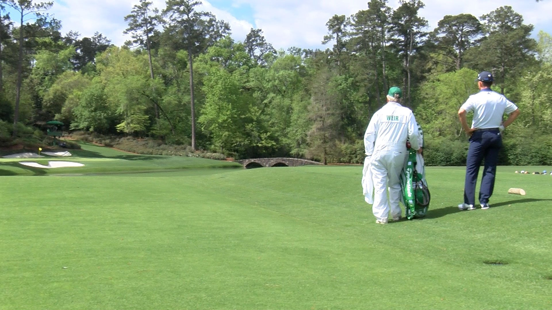 Mike Weir and his caddy stand at Amen Corner (WFXG)