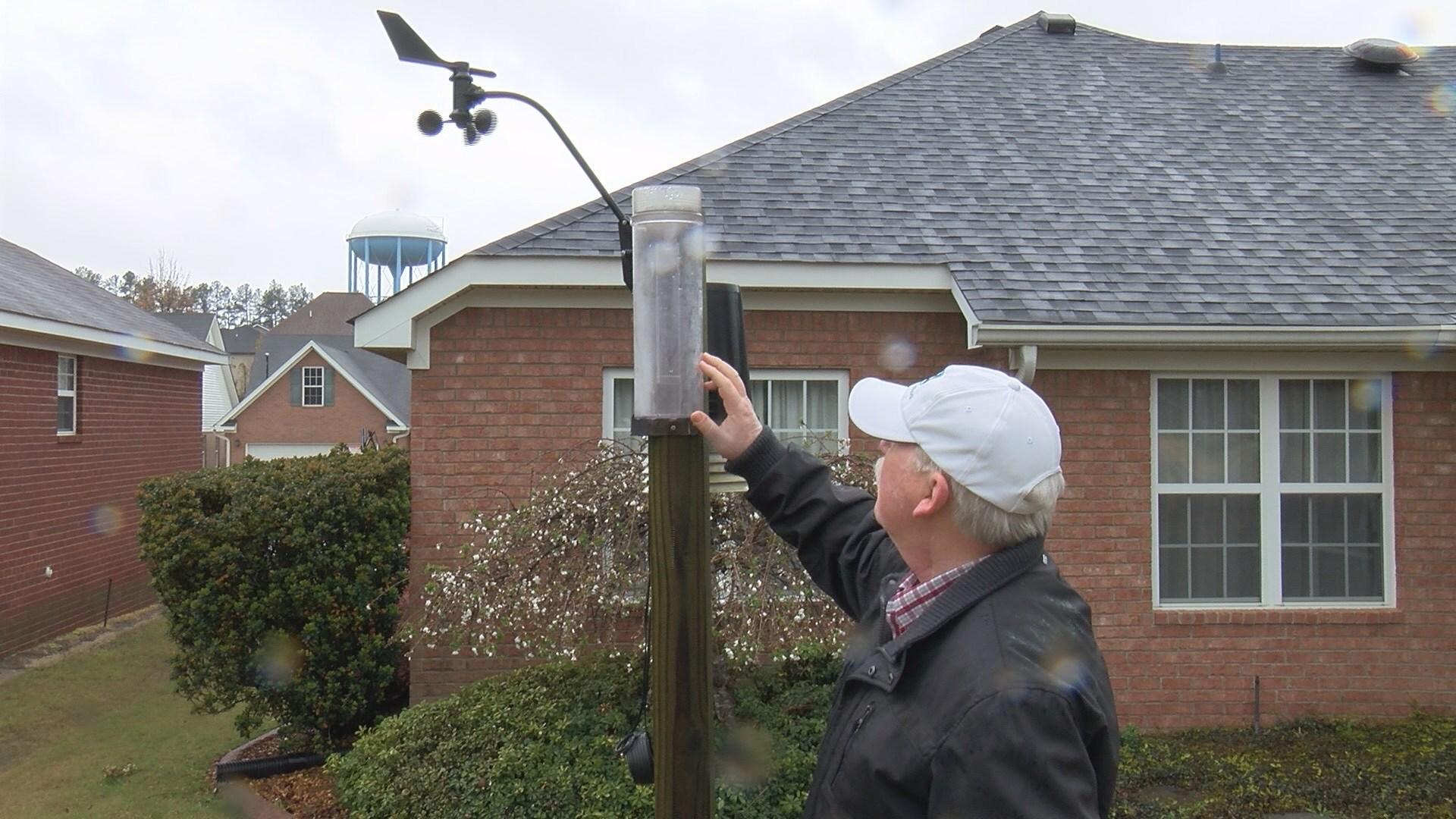 CoCoRaHS volunteer Richard Cutright checks the rain gauge behind his home in Grovetown, GA. (WFXG)