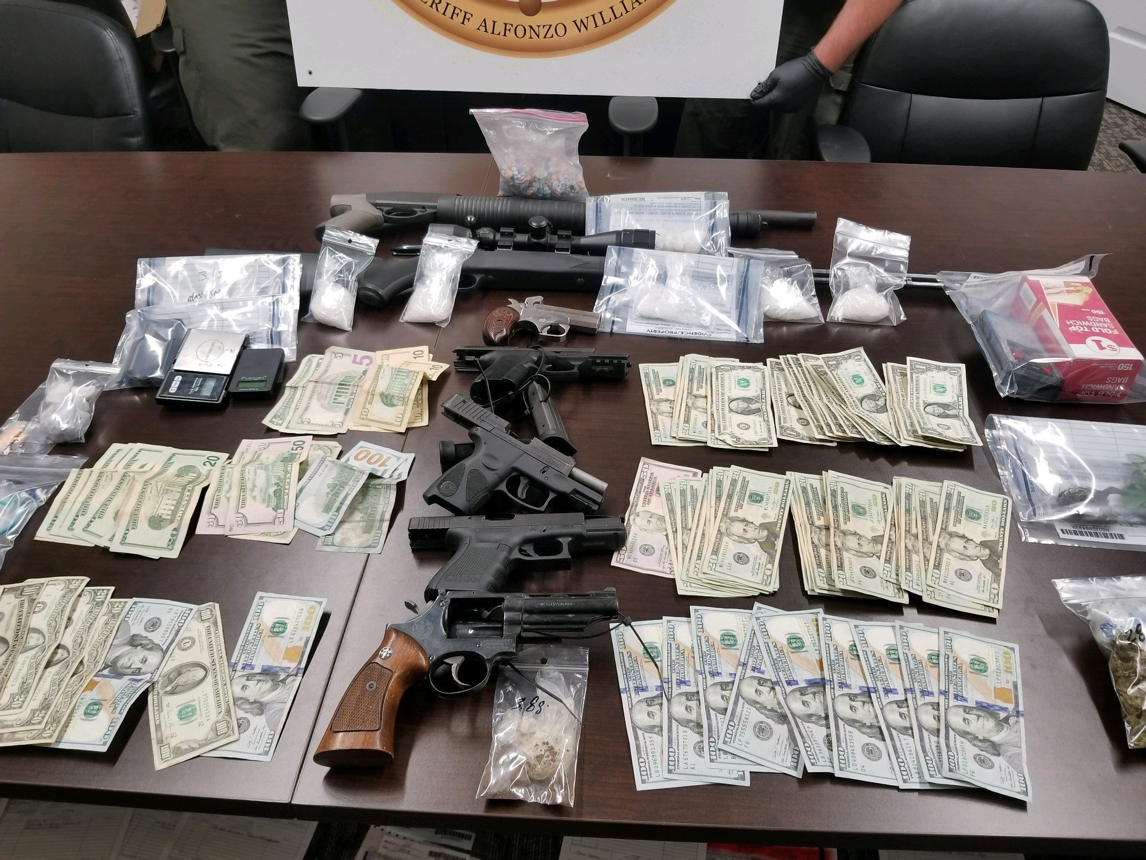Drugs, cash, and guns seized in Farmer's Bridge Cir. home (source: Burke County Sheriff's Office)