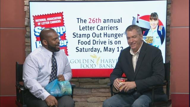 Travis McNeal talks with CE Huffman about how to donate to the Stamp Out Hunger Food Drive (WFXG)