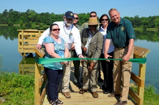 S.C. State Rep. Lonnie Hosey joined SCDNR officials and Thoroughbred Country Regional Tourism Marketing Director Mary Ann Keisler at a ribbon cutting ceremony for a new handicapped-accessible fishing pier at Lake Edgar Brown in Barnwell. (SCDNR/D. Lucas)