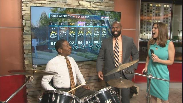 The FOX 54 News Now morning team standing around Jay's drumkit (WFXG)