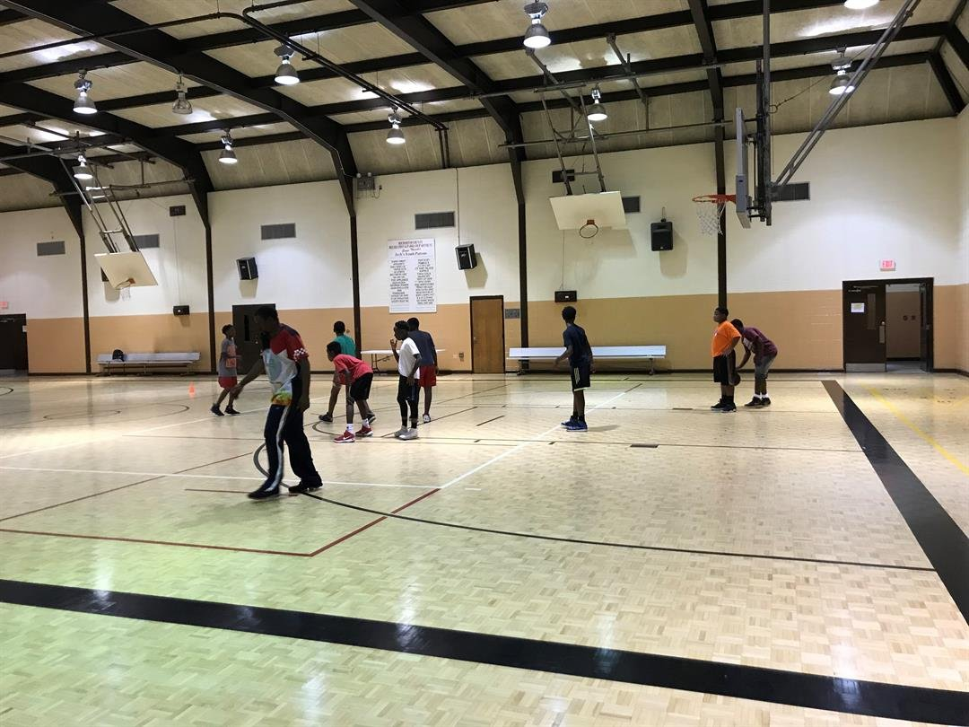Children play basketball inside the May Park Recreation Center (Source: WFXG)