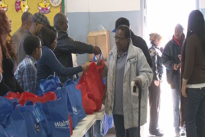 Families pick up free turkeys at the 2012 James Brown Turkey Giveaway. (Source: WFXG)