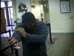 Deputies say the man in this photo robbed the SunTrust bank on Peach Orchard Road. (Source: RCSO)