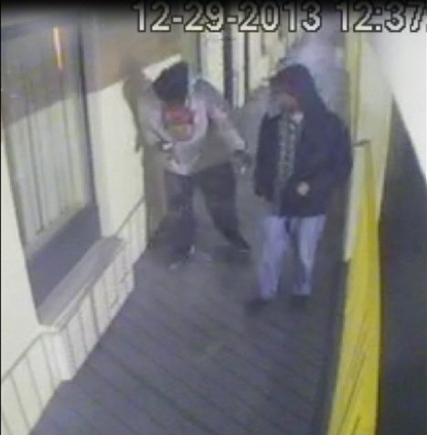 The man in the gray hoodie is wanted in connection with a fatal shooting at the Scottish Inn. The man in the black hoodie is a person of interest. (Source: Richmond Co. Sheriff's Office)