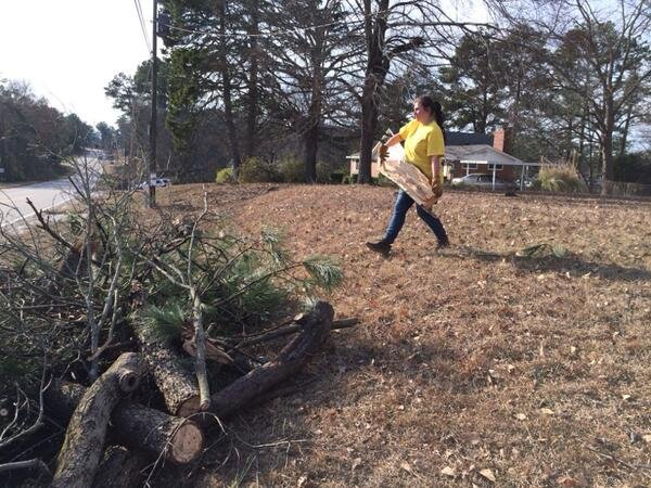 Volunteers from The Church of Jesus Christ of the Latter Day Saints help clean up ice storm damage in Columbia County. (Source: Nick Lulli/WFXG)