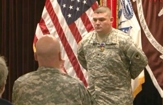 Specialist Joshua Cleveland receives his Purple Heart during a ceremony at Fort Gordon. (Source: Traci Washington/WFXG)