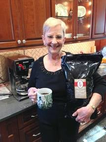 Georgia First Lady Sandra Deal holds a bag of Augusta-made Harvest Blend coffee. (Source: Golden Harvest Food Bank)