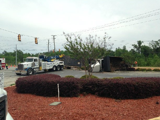 A truck carrying debris flipped over Tuesday afternoon in Aiken County.