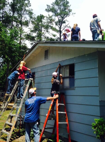 A group of students working through the mission program World Changers repair a house in Augusta. (Source: WFXG)