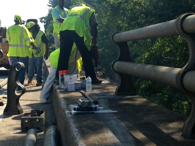 GDOT crews work to repair the guard rail on the I-20 bridge near the state line. (Source: WFXG)
