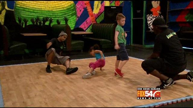 Ava and Adrian practice break dancing at Back Bar at 1102 in downtown Augusta. (Source: WFXG)