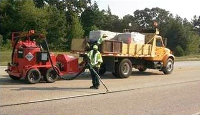 Crews work to seal crack in the roadway on Deans Bridge Road. (Source: GDOT)